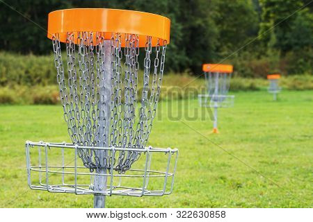 A Disc Golf Basket In The Park.