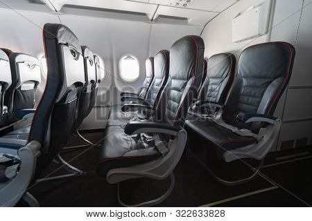 Airplane Seats And Windows. Economy Class Comfortable Seats Without Passengers. New Low-cost Carrier