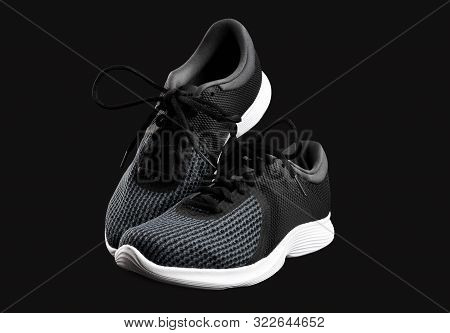 Sport Shoes Isolated On Black Background. Black Sneakers Running Shoes. Casual Shoes. Youth Style. S