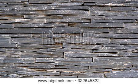 Wild Brawn Decorative Stone Background. Artificial Brawn Decorative Bricks Wall. Construction Made O
