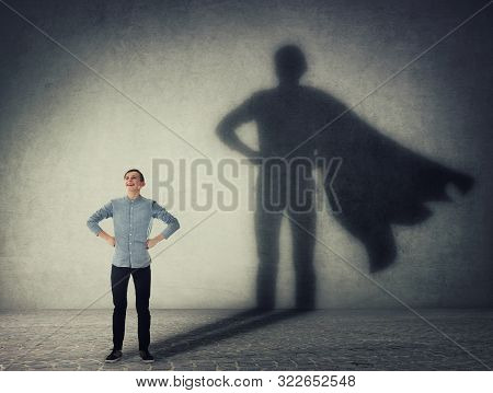 Casual Teenage, Keeps Arms On Hips Smiling Confident, Casting A Superhero With Cape Shadow On The Wa