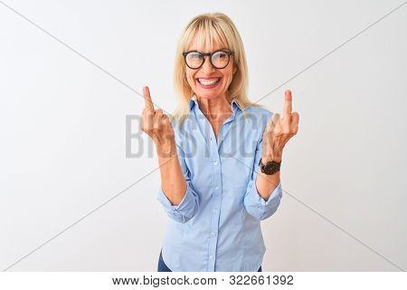 Middle age businesswoman wearing elegant shirt and glasses over isolated white background Showing middle finger doing fuck you bad expression, provocation and rude attitude. Screaming excited poster