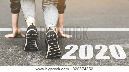 Woman In Sports Uniform Running Around. Healthy Way Of Life, An Infused Figure. Sneakers Close-up, F