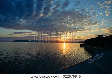 View Of Empty Black Sea Beach And Sky On Sunset Over Novorossiysk City Of Russia Background, Horizon