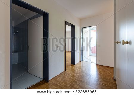 Corridor with large wardrobe and doors open to the bathroom, bedroom and kitchen. Nobody inside