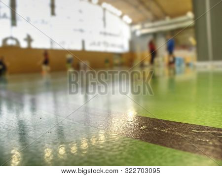 Detailed Green Floor In A School Gymnasium, Players Are Out Of Focus