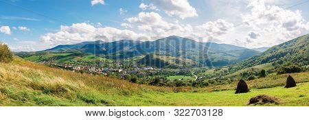 Wonderful Carpathian Countryside In The Afternoon. Sunny Weather With Fluffy Clouds On The Sky. Beau