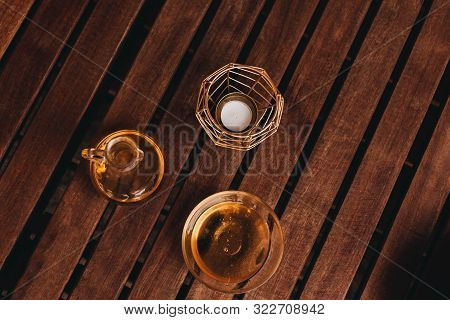 Massage Oil And Honey In Glass Jars On A Wooden Background. Candle In A Golden Candlestick. Spa Cent