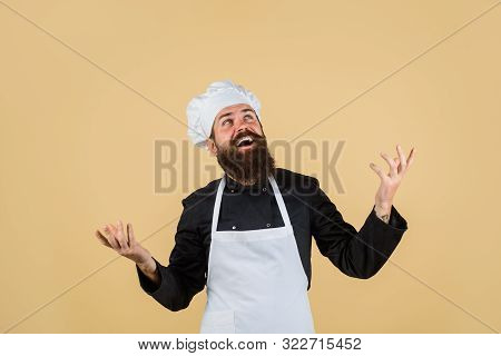 Chef Ready To Cooking New Dish. Bearded Man In Kitchen Apron. Male Cook In Chef Hat. Professional Co