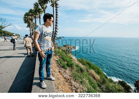Phuket, Thailand : May 2019 : Asia Man Looking To Seascape Of Phuket Best Sunset View Point Sunset A