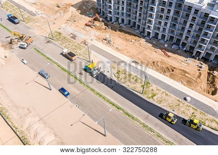 Road Rollers Doing Asphalt Pavement Works. Top View Of Road Construction Site