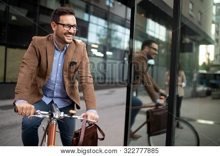 Happy Young Stylish Businessman Going To Work By Bike