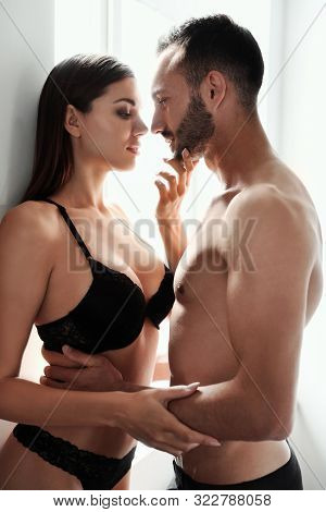 Passionate Young Couple Being Intimate At Home. Sex Foreplay