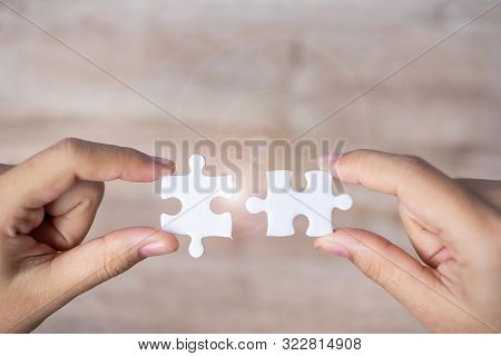 Businessman Hand Connecting Couple Puzzle Piece. Business Solutions, Mission Target, Successful, Goa