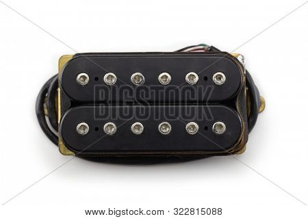 Electric guitar humbucker type magnetic pickup (double coil ) isolated on white background. Hex pole piece type. Black bobbin.