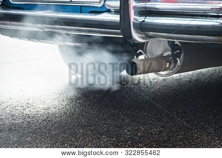 Combustion Fumes Coming Out Of Car Exhaust Pipe, Exhaust Gas From A Car With Diesel Or Gasoline Engi