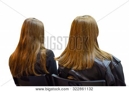 Two Girls Twins In Auditory During Presentation Or Seminar. Isolated Background. Teenagers Or Young
