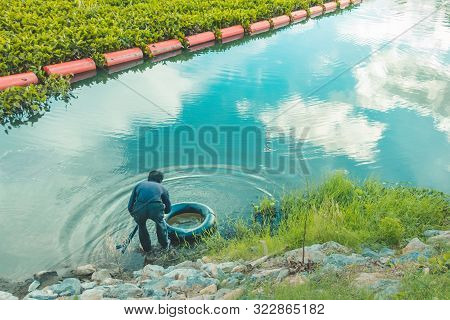 Underwater Hunter Diver Man With  Speargun Preparing To Dive On A Life Ring Looks Under The Water In
