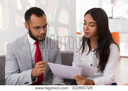 Businesswoman Consulting Legal Expert. Business Woman Showing And Giving Papers To Man In Suit In Of