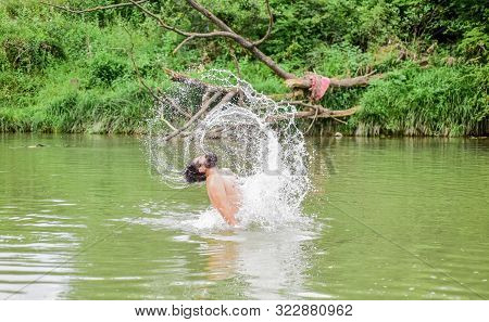Feeling Free. Bearded Man Swimming In Lake. Summer Vacation. Mature Swimmer. Brutal Hipster With Wet