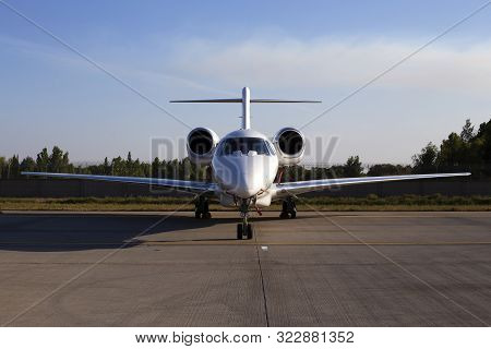 White Aircraft On The Parking Zone, Front View