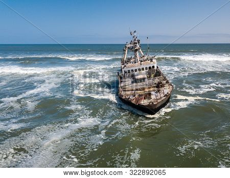 Abandoned And Derelict Old Shipwreck Zeila At The Atlantic Coast Near Swakopmund And Famous Skeleton