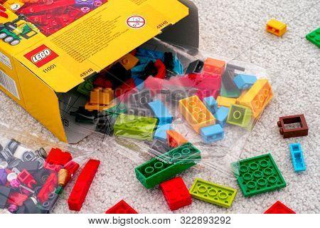 Tambov, Russian Federation - September 07, 2019 Lego Blocks And Bricks Spill Out Of Lego Box. Close-