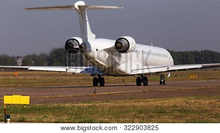 Big Modern White Aircraft Running To The Parking Area, Closeup
