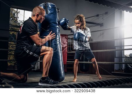 Experienced Boxer Trainer Is Training New Little Girl Boxer For Special Competitions Using Punching
