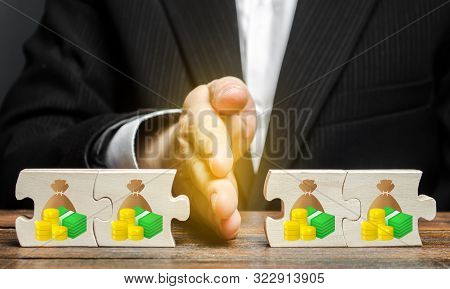 The Palm Of The Hand Divides The Puzzles Into Money In Half. Financial Management And Distribution O