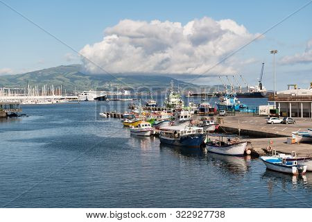Ponta Delgada, São Miguel Island, Azores - August 31 2019: Boats Moored In The Harbour With A Large