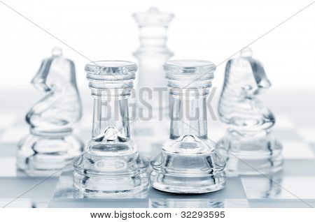 set of chess pieces are defending king, cut out from white