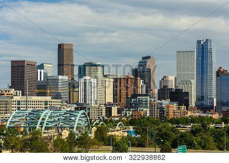 Downtown Denver, Colorado Skyscrapers With Confluence Park And The Speer Blvd. Platte River Bridges