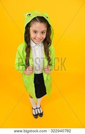 Frog Style. Schoolgirl Hooded Raincoat Enjoy Fall Weather. Rainproof Accessories Make Rainy Fall Day