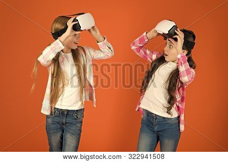 Discover Virtual Reality. Kids Girls Play Virtual Reality Game. Friends Interact In Vr. Explore Alte
