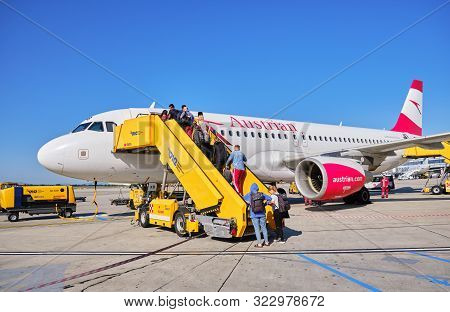 Schwechat, Austria - September 15, 2019: Passengers Boarding An Austrian Airlines Airplane At Vienna