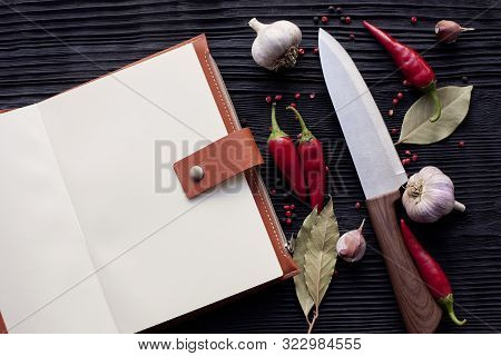 Notepad  Chef  Knife Garlic  Chili And  On A Wooden Dark Background
