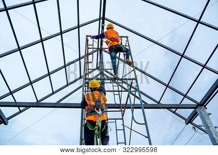 Construction Worker Wearing Safety Harness Using Secondary Safety Device Connecting Into 15 Mm Stati