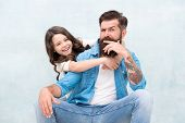 Strengthening father daughter relationships. Child and dad best friends. Friendly relations. Fathers day concept. Lovely father and cute kid. Family hug. Father and daughter hug light background. poster