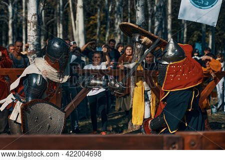 Festival Of Medieval Culture. Imitation Of Jousting Tournaments. Sword Fighting. Arena With Spectato