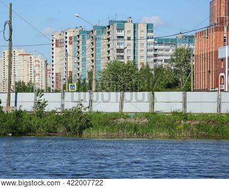 Fenced Pond On The Outskirts Of The City, Ulitsa Voroshilova, Saint Petersburg, Russia, May 2021