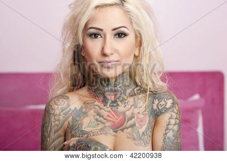 Portrait of a beautiful young tattooed woman