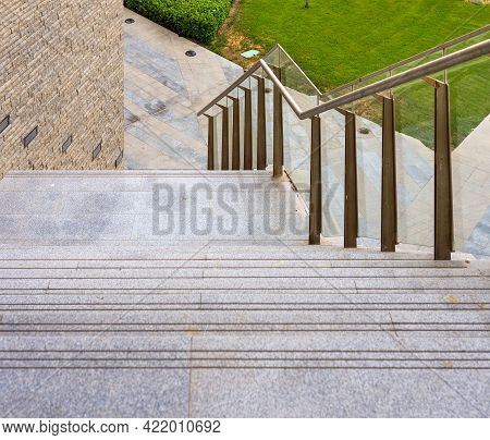 Marble Staircase And Glass Handrail Leading To Street From Contemporary City Office Building