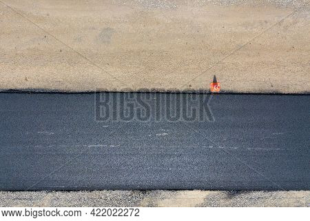 Aerial View Of New Road Construction With Newly Layed Black Asphalt Lane.