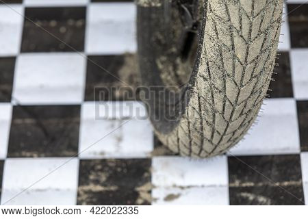 The Wheel Of The Motorcycle Is Sporty For Cross And Motorcycle Freestyle, Racing Against The Backgro