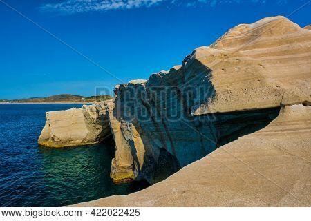 White rocks of famous tourist attraction of Milos island Sarakiniko beach and Aegean sea, Milos island , Reece