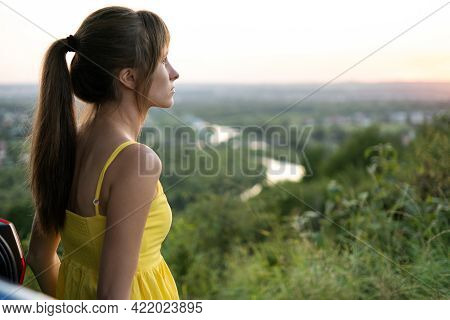 Yong Happy Female Driver Resting Near Her Car Enjoying Sunset View Of Summer Nature. Travel And Recr