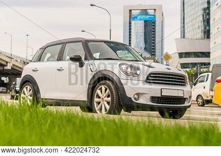 Moscow, Russia - May 2021: Mini Countryman Is Accelerating In Highway On Urban Background. Mini Cros