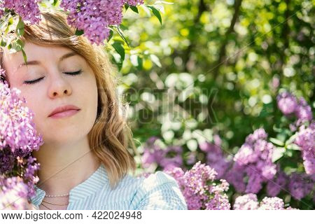 Candid Authentic Portrait Of 30s 40s Caucasian Blonde Woman With Lilac Flowers. 30 40 Year Old Woman