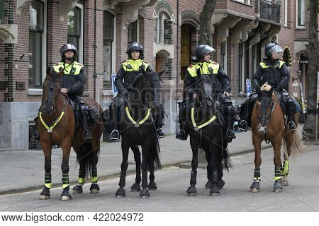 Amsterdam , Holland - 16 Mei 2019:  Police Officers In Uniform On Their Horses With Protection For T